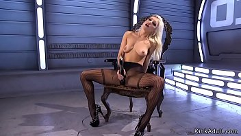 Beautiful blonde in high heels fucks machine