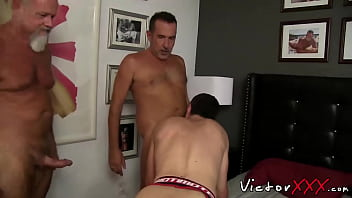Three guys enjoying hardcore bareback and double penetration