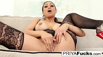 CoverSexy busty MILF Priya Rai pleases her sexual urges