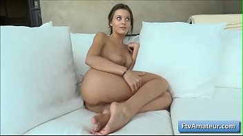 Sexy brunette natural big tit amater babe Lana talk dirty while sitting naked on a sofa