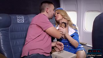 Busty flight attendant - Big tits blonde stewardess joins the mile high club