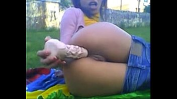 Young teen in jeans masturbates her pussy and ass with a huge dildo outside