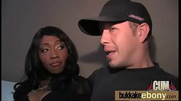Ebony takes a facial in a club bukkake party 20