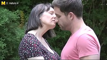 Mom And Son Enjoy Together In Natural Surroundings Outdoors