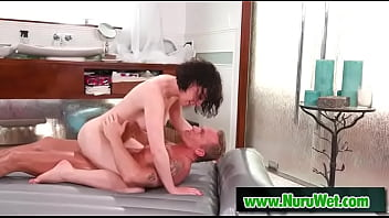 Brunette masseuse fucked covered in nuru gel