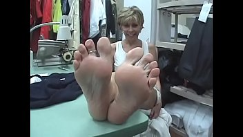 Unaware Seamstress With Very Sexy Soles Feet