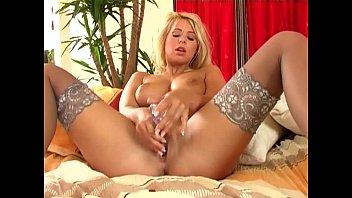 Blonde babe in stockings fingers her shaved pussy Vorschaubild
