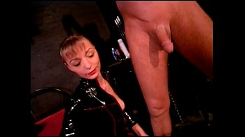 Hot domina taking care of man and woman