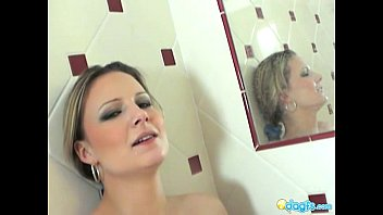 Holly washing her massive tits in the shower