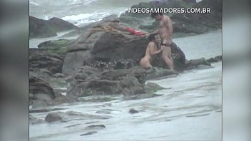 Couple is caught fucking on the beach during storm