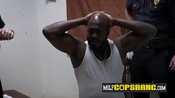 Black stud is banging two curvy MILFs with big tits in the interrogation room.