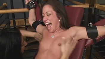 Girl in chair tickled