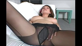Free pantyhose video clips - Busty brunette milf teases in black pantyhose