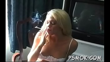 Dirty slut pleasing her fellow while smoking a cigarette