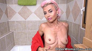 A hot shower sends mature Sunny into a dildo masturbation frenzy