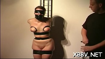 Undressed breasts Undressed wife stands fastened up and endures heavy breast bondage
