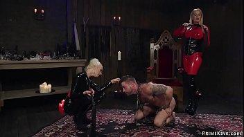 Latex femdoms whipping tattooed slave