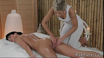 Blonde masseuse rubs and oils ass and pussy of brunette hottie