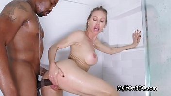 Busty MILF showers with big black cock
