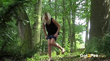 Blonde gushes piss while in the woods preview image