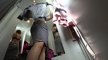 Wearing lingerie in public Peeping into the public dressing room, a view from below on a juicy ass and on a sexy girl with long legs, hidden camera.