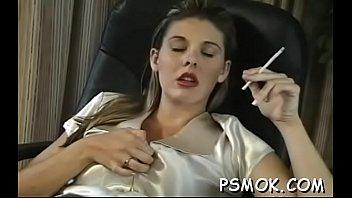 Juvenile girl sitting and enjoying a relaxing smoke