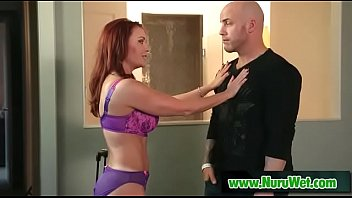 Busty masseuse Janet Mason prepares her client for massage