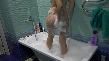 Babe with hairy pussy and big ass takes a bath and masturbates with water. Fetish.