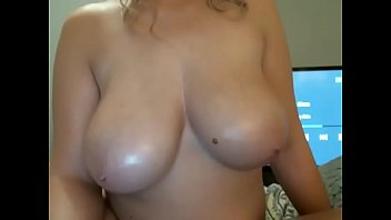 Hot woman showing big round tits on cam