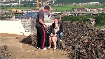Public fuck of a cute blonde girl by 2 guys at a construction site