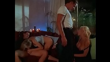 Two hot blondes have sex with two hot studs in dim lit room then share cumshots