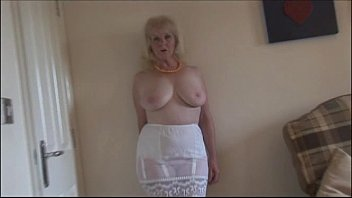 Mature busty lady in stockings and sheer slip strips Thumb