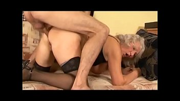 Mature slut Könyvesné Kiss Mária gets warmed up with a dildo then young dude comes to bang her