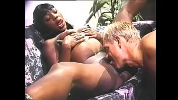 Watch black girl Menaja Twa get on top of his white cock and ride him hard on couch
