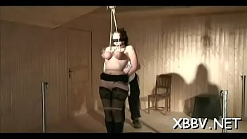 Hardcore torture - Naked chick stands with her big boobs fastened up in ropes