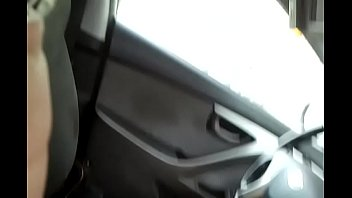 Flowers giving another blowjob in her car