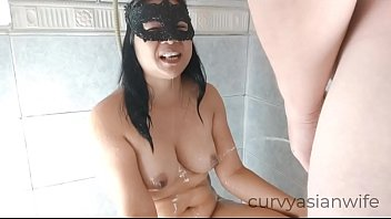 Pissing on my Asian slut wife to wash off my cum