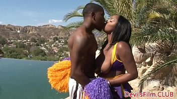 Black busty cheerleader rides cock outdoors
