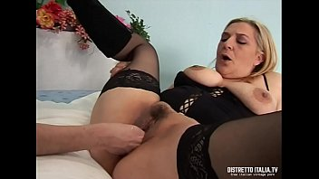 Old slut with boots and stockings screwed and penetrated with a fist in the hairy pussy by a young guy