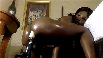 Busty Ebony Tranny Using Her Sex Machine