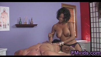 Cute ebony masseuse plays with cock
