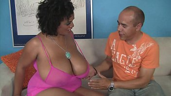 Amazing black slut with huge boobs enjoys a mature cock