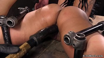 Ebony in metal device pussy dildo banged