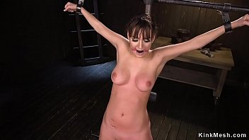 Locked in device brunette gets tormented