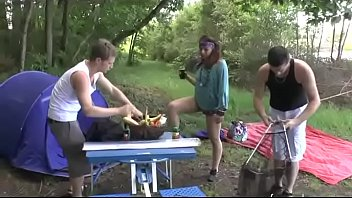 A girl fucked hard by two guys in a camping