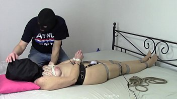 Wife in bondage and with plastic bag