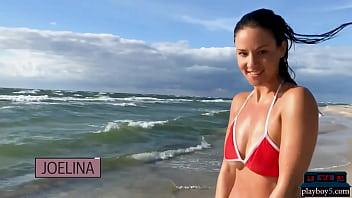 German MILF model Joelina strips naked on the beach