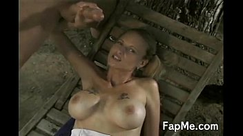 Busty slut gives head to two guys