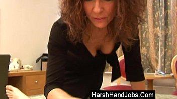 Mature brunette gives a harsh handjob