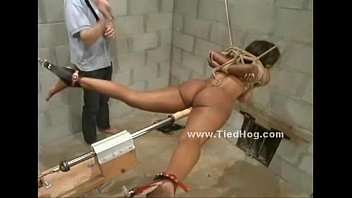 Nasty mistress with ponytail slapping naked sex slave tied like a hog in ropes